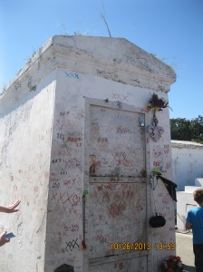 Marie Laveau's tomb. Psst...desecrating the tomb will not make your wish come true. Just sayin'.