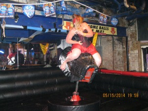 They ride mechanical bulls dressed as a pirate, holding in the goods.