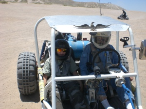 Uncle Cecil driving a car he made from scratch. His dune racers were so much fun!